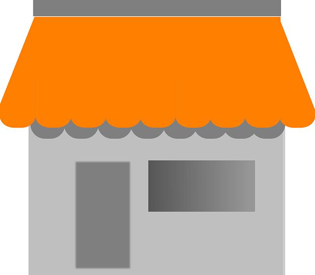 šedý domek, oranžová střecha